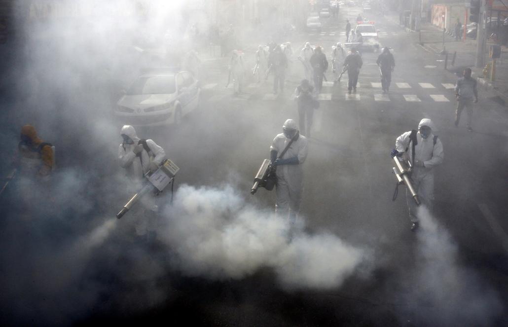 NAGYÍTÁS ÉV KÉPEI Iranian Firefighters disinfect streets in the capital Tehran in a bid to halt the wild spread of coronavirus on March 13 2020.