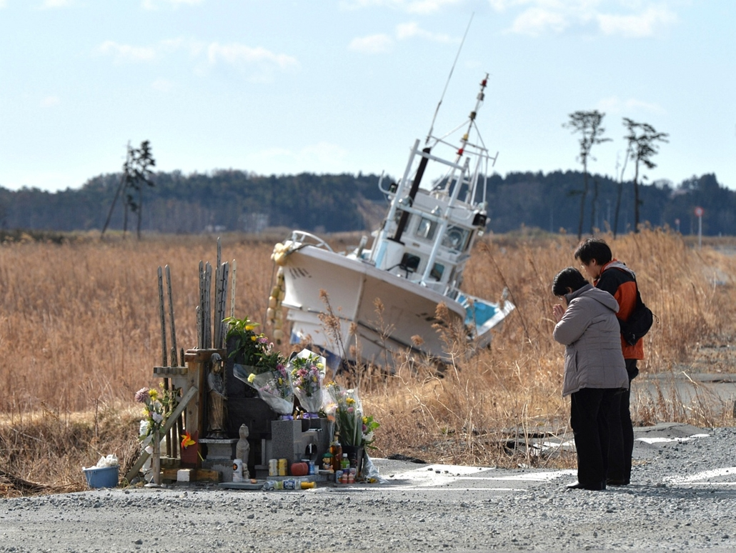 afp.14.03.11. - Namie, Japán: a fukusimai áldozatokért imádkoznak