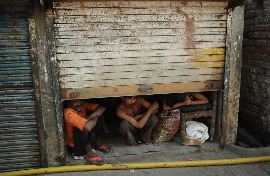 afp. hét képei - nagyítás - 214.01.28. India, Mumbai, nyomornegyed