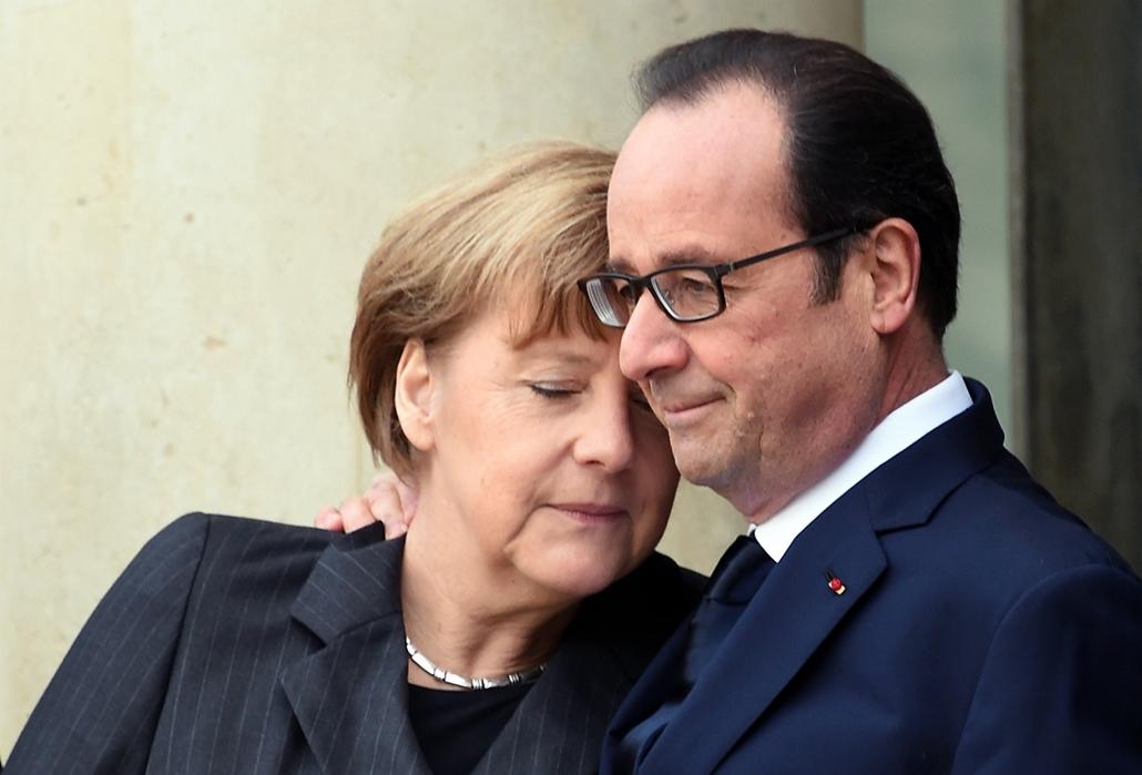 afp. 2015.01.11. Francaiország, Párizs, lövöldözés Párizsban, Charlie Hebdo, tüntetés, terrorizmus elleni menet, Angela Merkel, Frnacois Hollande