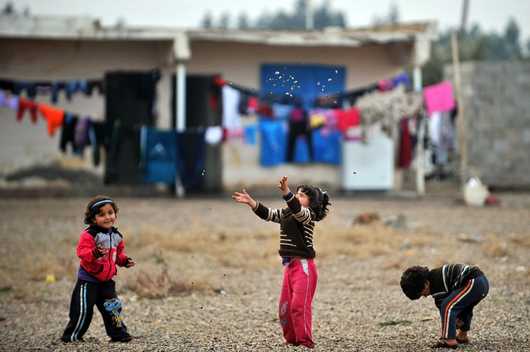 afp. 0113-019 - hét képei - 2014.01.15. Törökország, Reyhanli, szíriai gyerekek játszanak, menekülttábor